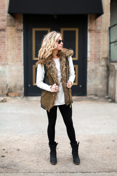 white crew neck sweater with faux fur olive green military vest