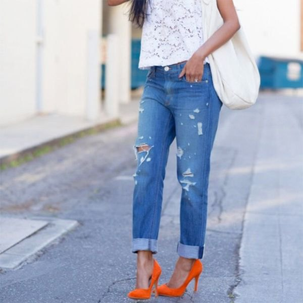 white lace short sleeve top with blue cuffed boyfriend jeans