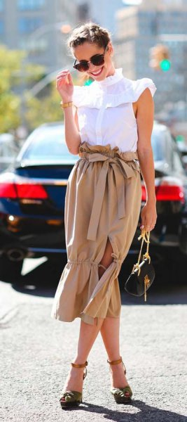 white mock neck sleeveless ruffle shoulder shirt with blush tie waist midi skirt