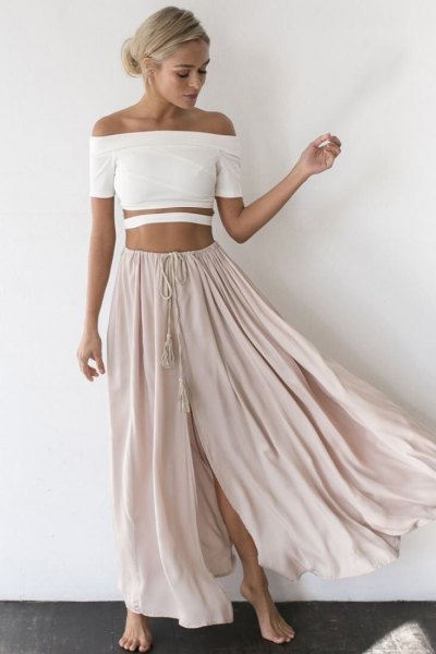 white off the shoulder crop top with light grey long flowy skirt