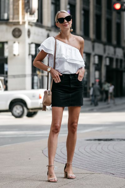 white one shoulder ruffle top with black mini skirt