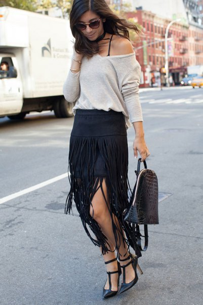 white one shoulder sweater with black maxi fringe skirt