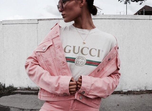white print tee with pale pink denim jacket and matching jeans