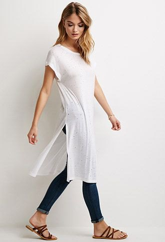 white side slit long t shirt with blue cuffed skinny jeans