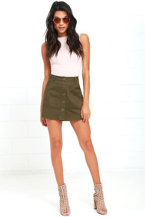 white sleeveless fitted top with olive green button front mini skirt
