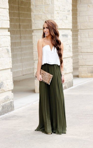 white sweetheart neckline blouse with dark green pleated long skirt