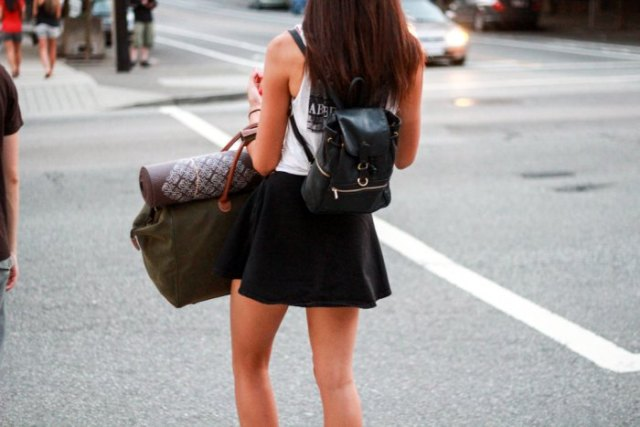 white tank top with mini skater skirt and black backpack purse