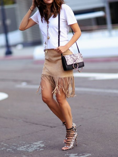 white tee with mini grey fringe skirt and heels