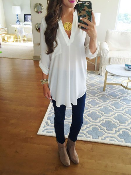 white tunic v neck top with grey suede ankle boots