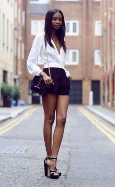white v neck puff sleeve blouse with black mini shorts
