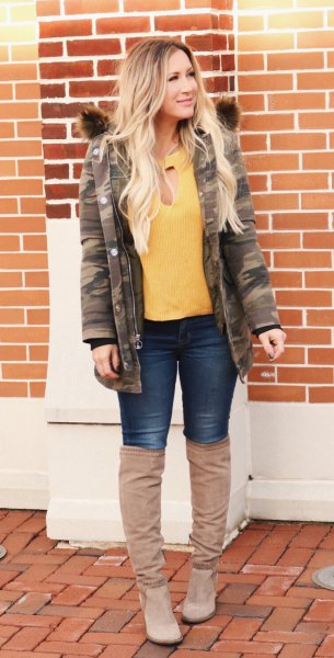 yellow blouse with camo jacket and over the knee boots
