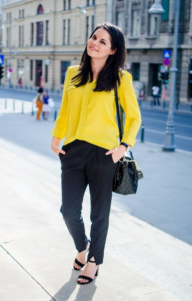 yellow button up shirt with black chinos and heeled sandals