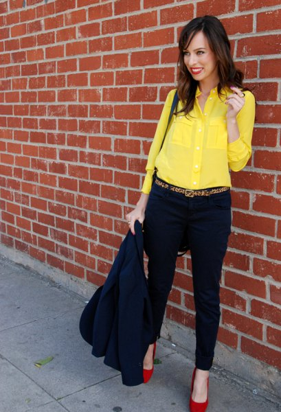 yellow button up shirt with black chinos and red heels