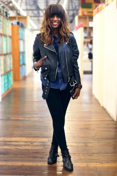 biker jacket with blue chambray button up shirt and black leather ankle moto boots