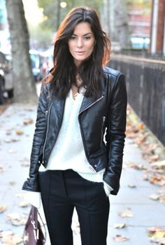 biker jacket with white v neck knit sweater and black chinos