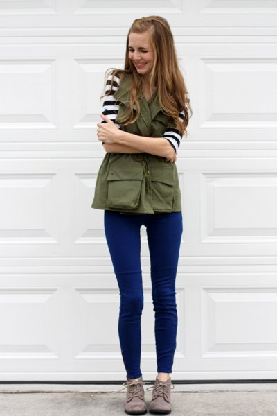 black and white striped t shirt with olive green vest and blue skinny jeans