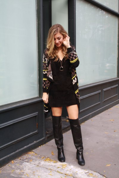 black and yellow printed cardigan with mini shift dress and leather long boots