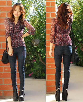 black chiffon semi sheer blouse with dark skinny jeans and high heel leather ankle boots