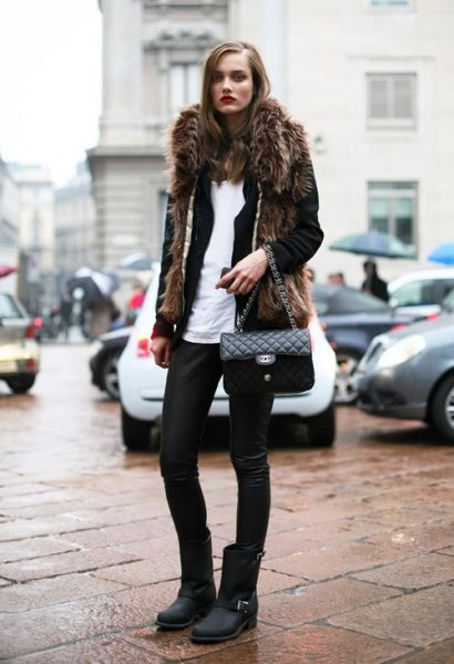 black faux fur coat with leather pants and matte moto boots