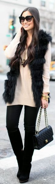 black faux fur vest with white sweater and black skinny jeans