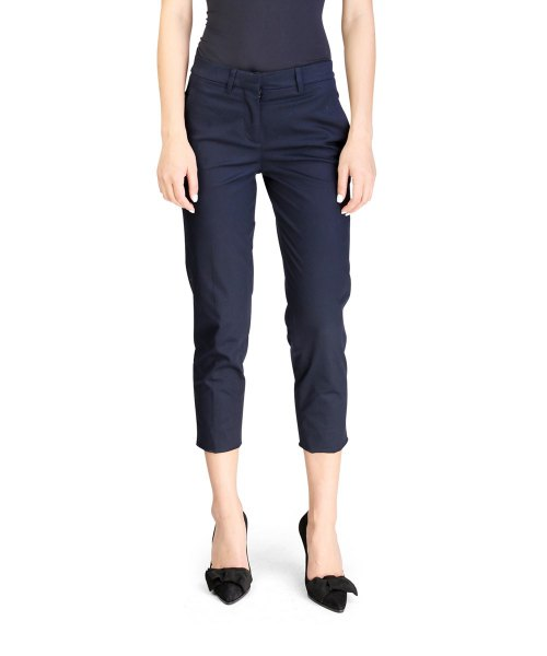 black form fitting tank top with navy blue cropped slim fit chinos