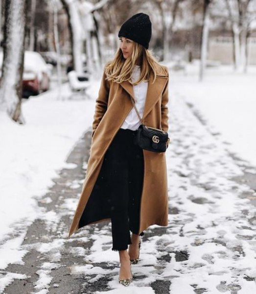 black knit hat with camel maxi length wool coat and cropped jeans