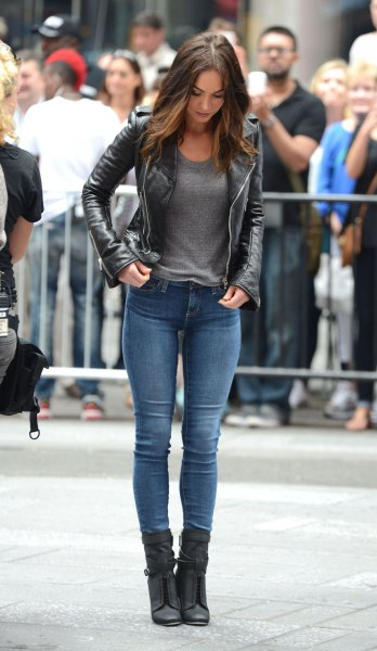 black leather jacket with skinny jeans and ankle lace up boots