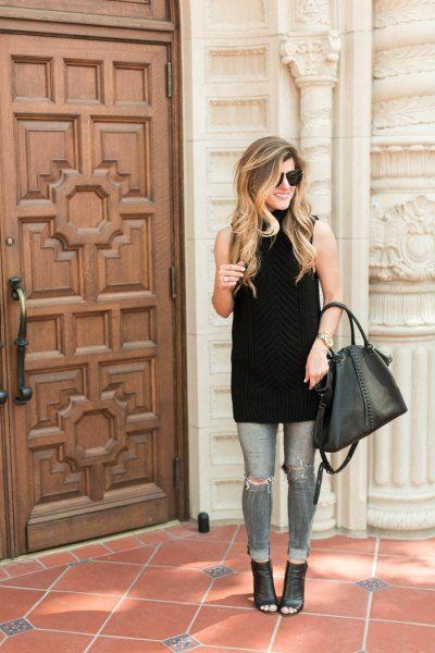 black sleeveless turtleneck tunic with grey ripped skinny jeans