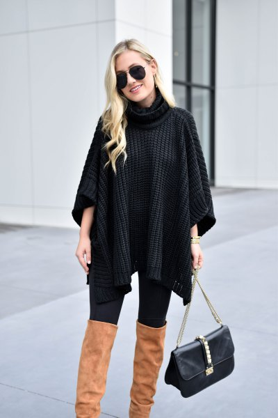 black turtleneck cable knit poncho sweater with camel thigh high boots