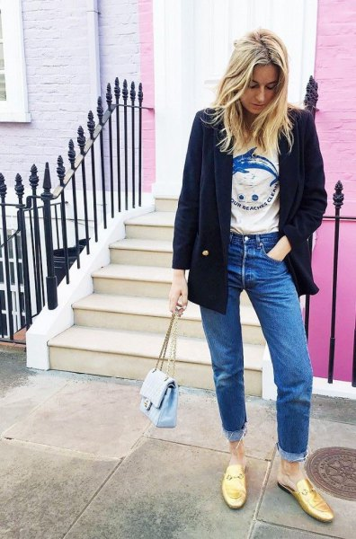 black wool blazer with print tee and golden backless loafers