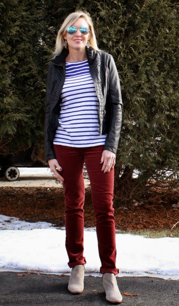 blue and white striped tee with black moto jacket and brown pants