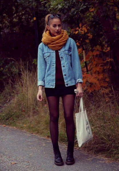 blue denim jacket with lime green scarf and black mini dress