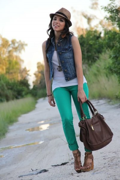 blue denim vest with light grey cuffed jeans