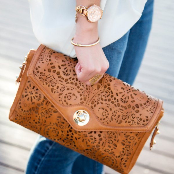 brown cutout soft leather clutch bag with white chiffon blouse and blue jeans