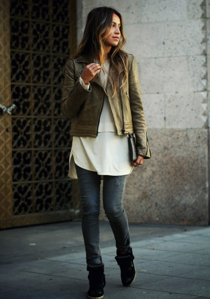 brown leather biker jacket with white tunic top and grey jeans