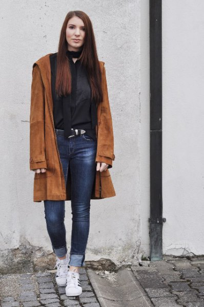 brown suede coat with black choker neck blouse and cuffed jeans