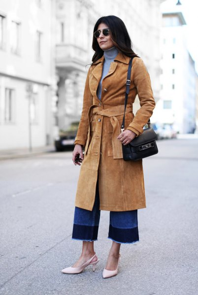 camel belted midi length suede coat with blue turtleneck sweater