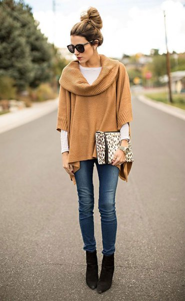 camel ribbed poncho sweater with sleeves and black pointed toe ankle boots