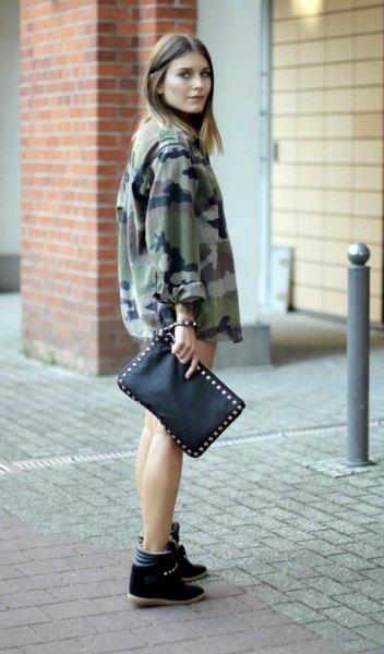camo windbreaker with mini denim shorts and black wege sneakers