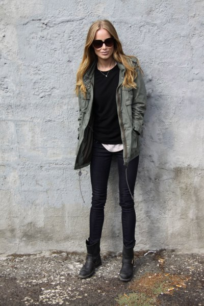 dark grey utility jacket with black sweater and white tee