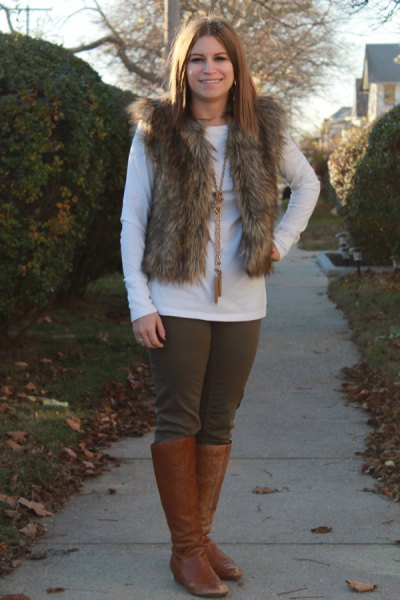 fur vest with white long sleeve tee and brown leather knee high boots