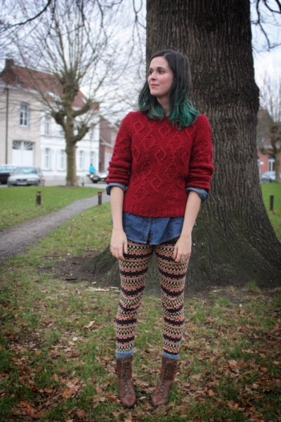 green cable knit sweater with chambray shirt and knit printed leggings
