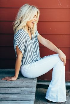 grey and white striped short wide sleeve button up shirt with bell bottom jeans