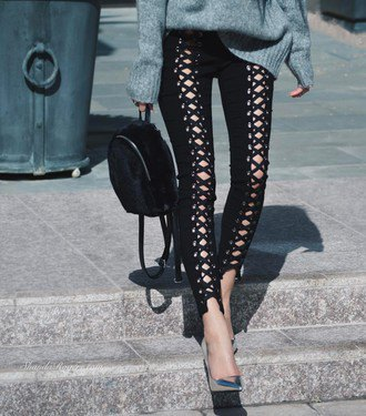 grey chunky knit sweater with black lace up cutout leather pants