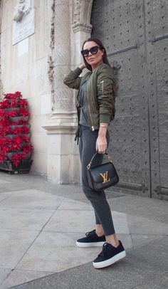 grey hooded bomber jacket with leggings and black sneakers