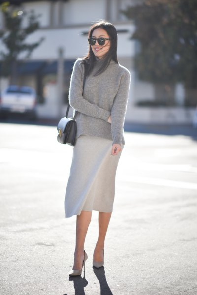 grey mock neck sweater with knee length skirt