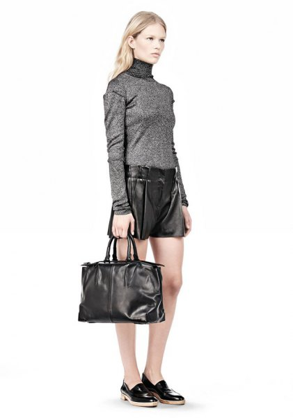 grey mock neck sweater with shorts and black soft leather handbag