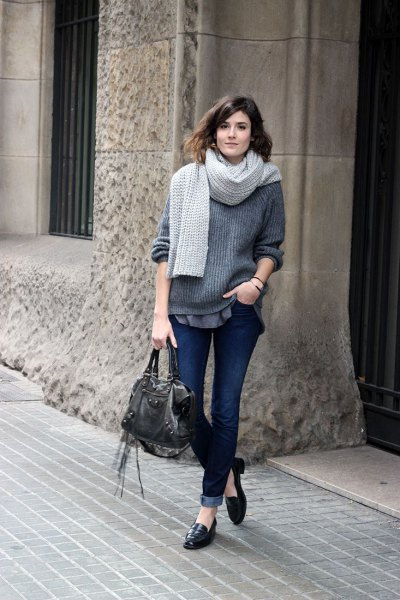 grey ribbed chunky sweater with cuffed dark jeans and leather slip on loafers
