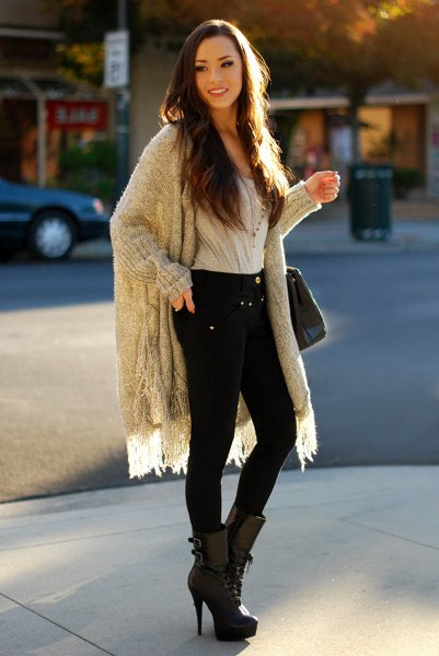 grey ribbed longline fringe sweater with black skinny jeans and high heel mid calf boots