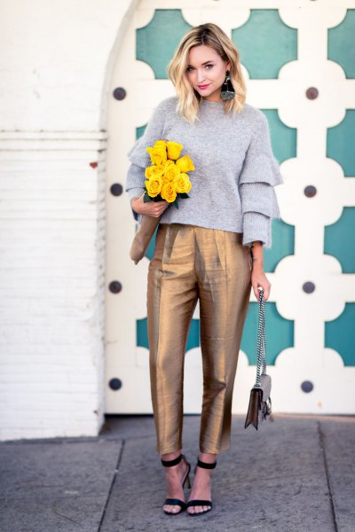 grey ruffle sleeve crew neck sweater with gold high waisted ankle chinos